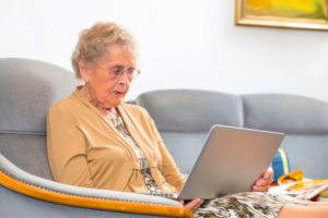 older woman looking at laptop computer